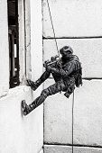 image of roping  - Spec ops police officer SWAT during rope exercises with weapons