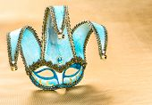 picture of harlequin  - Venetian carnival mask harlequin over golden background - JPG