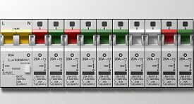 image of breaker  - A row of switched on household electrical circuit breakers on a wall panel - JPG