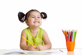 stock photo of pencils  - happy kid girl drawing with colourful pencils - JPG