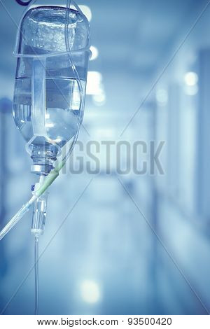 Medical Drip On The Background Of Blurred Hospital Corridor Concept