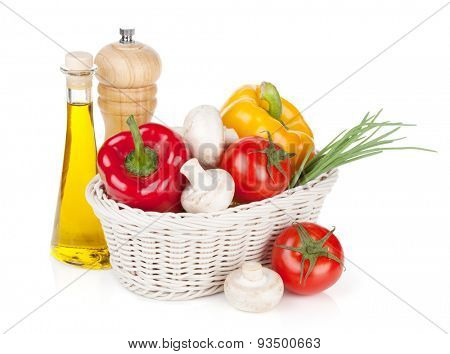 Fresh vegetables and mushrooms with olive oil and pepper shaker. Isolated on white background