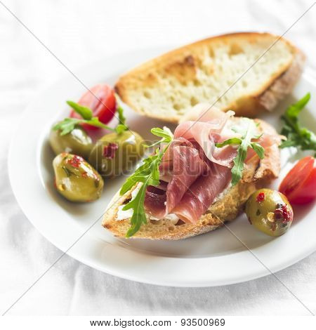 Delicious Appetizer To Wine - Toast With Ham, Olives And Cherry Tomatoes