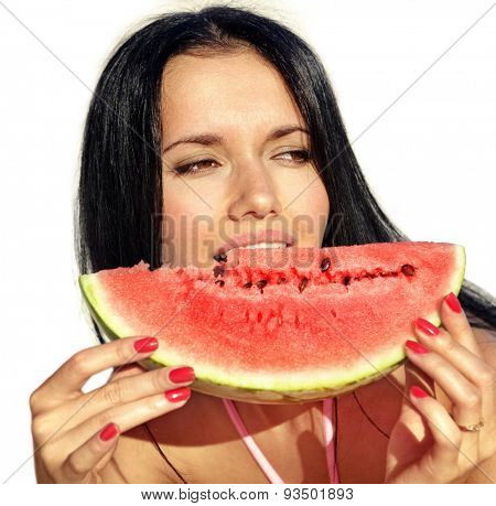 attractive girl eats a slice of ripe water-melon