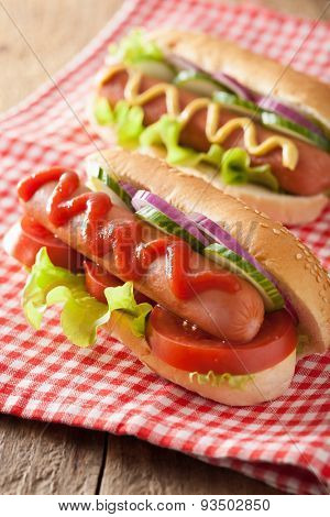 hotdog with ketchup mustard and vegetables