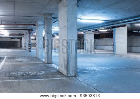 Dark parking garage industrial room interior with blue light