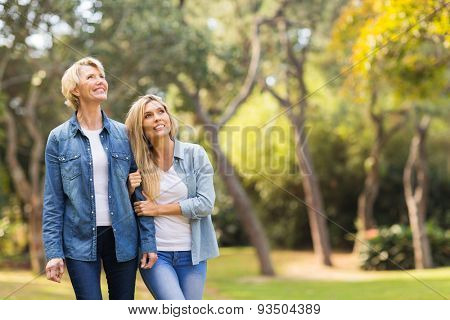 happy mother and daughter in the forest bird watching