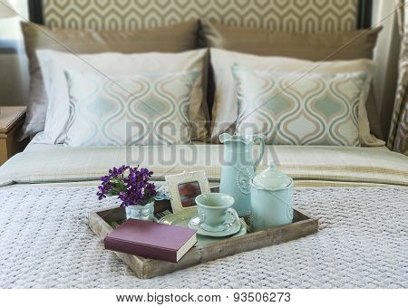 Decorative tray on the bed