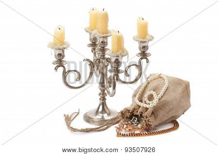 Old Candlestick With Candles And Sack Jewelry