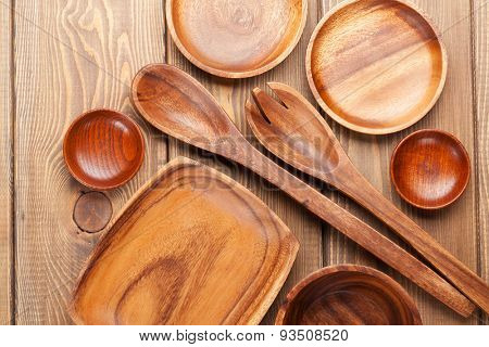 Wood kitchen utensils over wooden table background with copy space