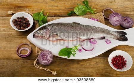 Raw Rainbow Trouts On A  Rustic Wooden Table.