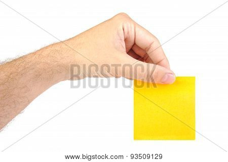 Hand holding one yellow notepaper or post it isolated on a white  background