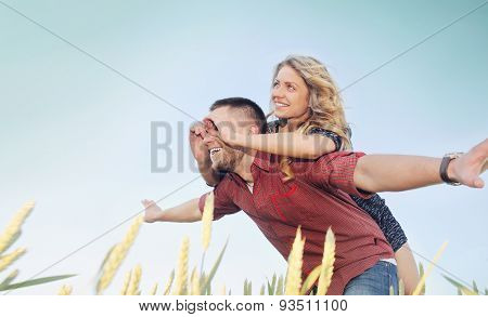 Happy Young Couple Have Fun At The Field In Summer, Happy Future Concept