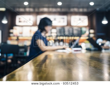 Blurred Woman working with laptop on table in cafe restaurant background