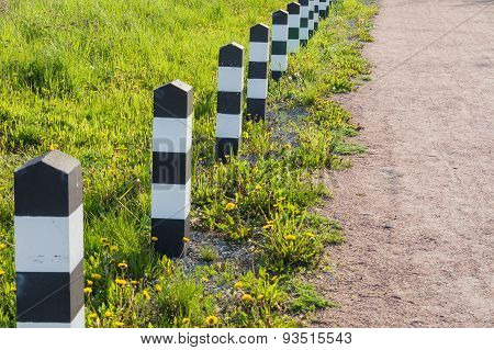 Footpath Decorative Fence. Black-white Striped Wooden Posts