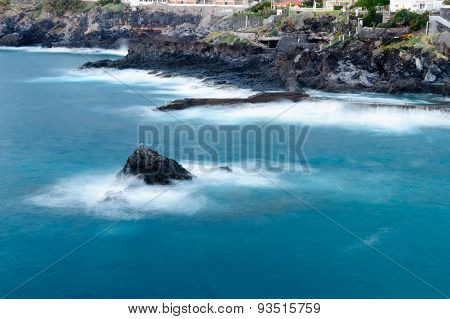 Long Exposure View Of Rocky Seashore With Deep Blue Water. Los Gigantes, Tenerife, Canary Islands