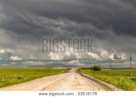 Remote Dirt Track Leads To Stormy Horizon