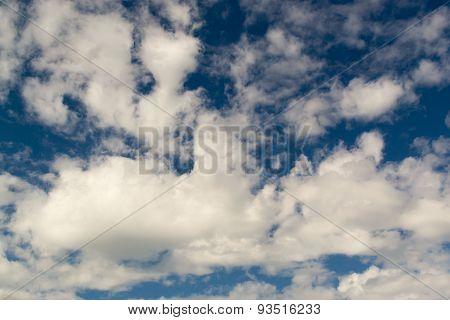 Wispy White Clouds Against Dark Blue Sky