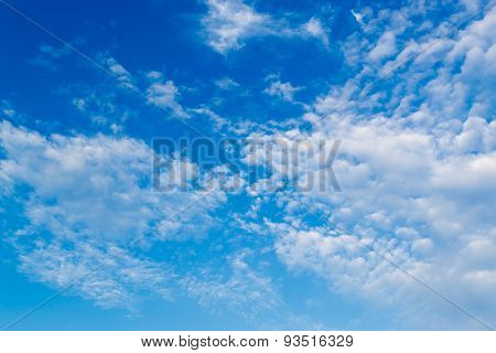 High Altitude White Clouds And Blue Sky