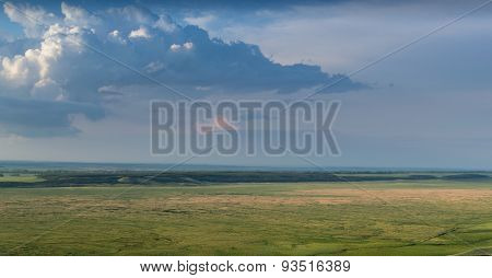 Big Rain Clouds Gather Over A Steppe