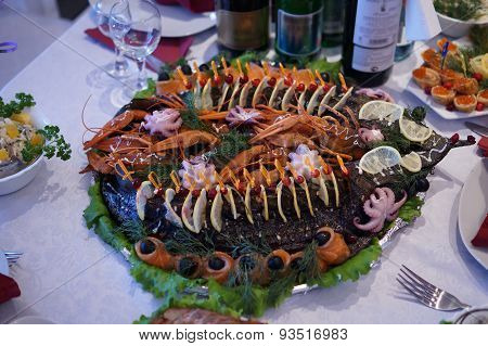 A dish of roasted pike, crabs, salmon and octopus