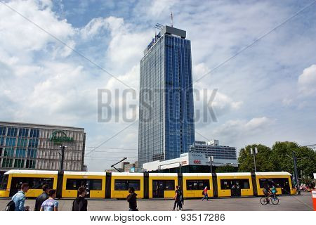 Public Transport On The Background Of A Skyscraper At The Alexanderplatz