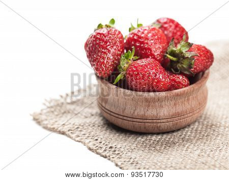 Ripe Strawberry In Wooden Bowl
