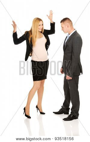 Pregnant woman arguing with her business partner