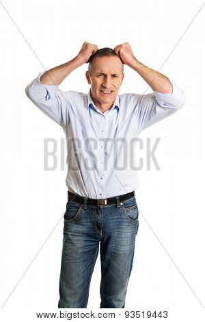 Frustrated man pulling his hair.