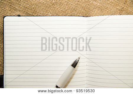 Opened Notebook And Pen On The Old Tissue