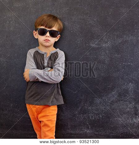 Smart Little Boy Standing Against Blackboard