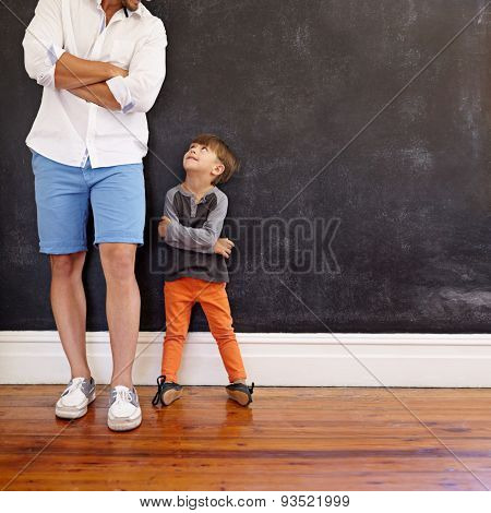 Little Boy Imitating His Father's Pose