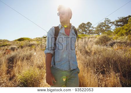 Man Hiking In Nature On A Sunny Day