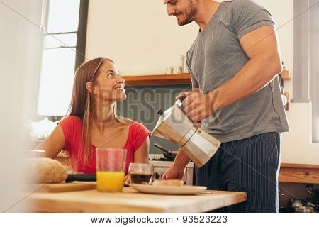 Man Serving Breakfast To His Girlfriend