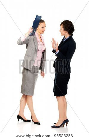 Angry businesswoman disagree with her friend idea.