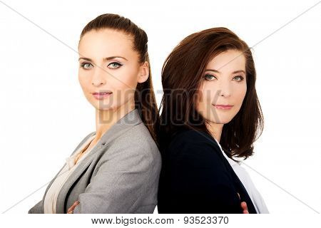 Beautiful two businesswomen leaning on each other.