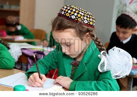 Ashgabat, Turkmenistan - November 4, 2014 .  Portrait Of An Unknown Schoolgir A Drawing Lesson