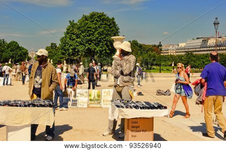 Paris, France - August 19, 2014. Two Sellers Sell Souvenirs Souvenirs In Jardin Des Tuileries On Aug