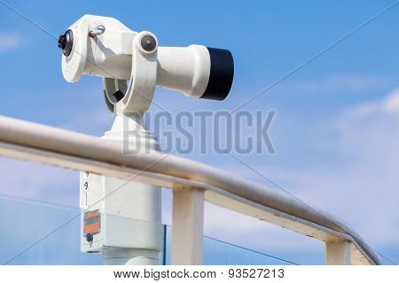 White Stationary Paid Telescope On Sea Coast