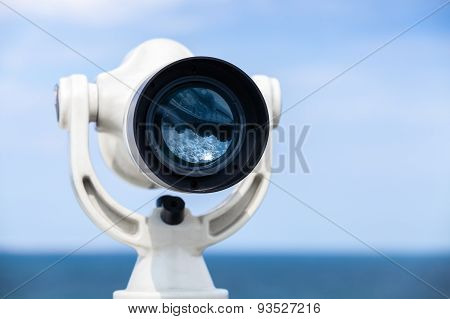 White Paid Telescope Stands On Sea Coast
