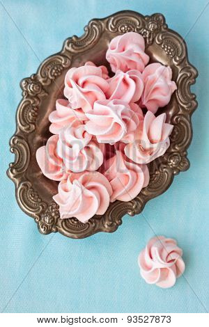 Pink Meringue In Antique Old Plate, On Blue Background,  Top View