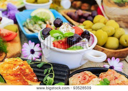Greek cuisine dishes - feta, choriatiki, halloumi, tzatziki, sardines