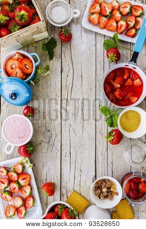 Strawberries - strawberries delight on wooden background, frame