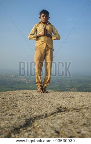 KAMALAPURAM, INDIA - 03 FEBRUARY: Indian pilgrim with hands in praying position on hilltop