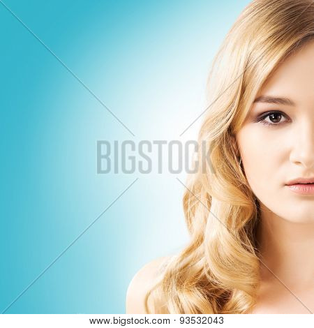 Portrait of young and beautiful teenage girl over teal background