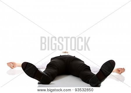 Young exhausted businessman lying on the floor.