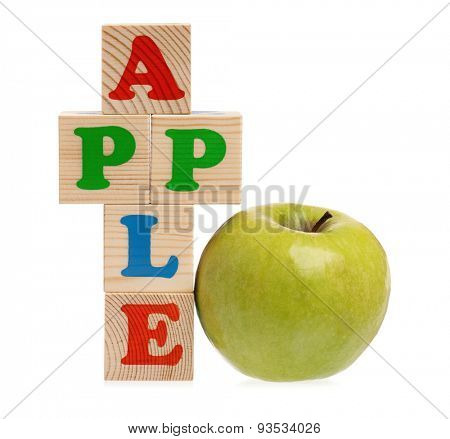 Apple word formed by wood alphabet blocks with fresh green apple on white background
