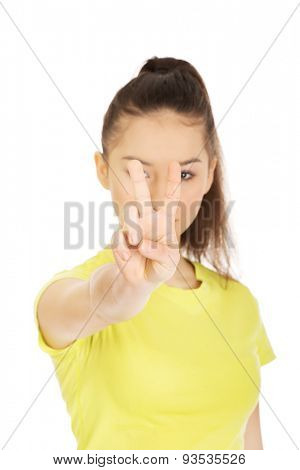 Young smiling student woman showing victory sign.