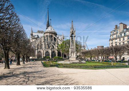 Cathedral of Notre Dame de Paris against the blue clear sky.