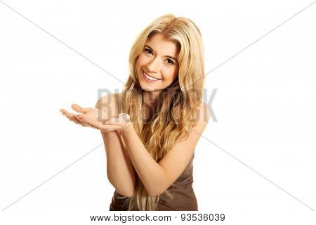 Student woman holding copyspace in both hands.